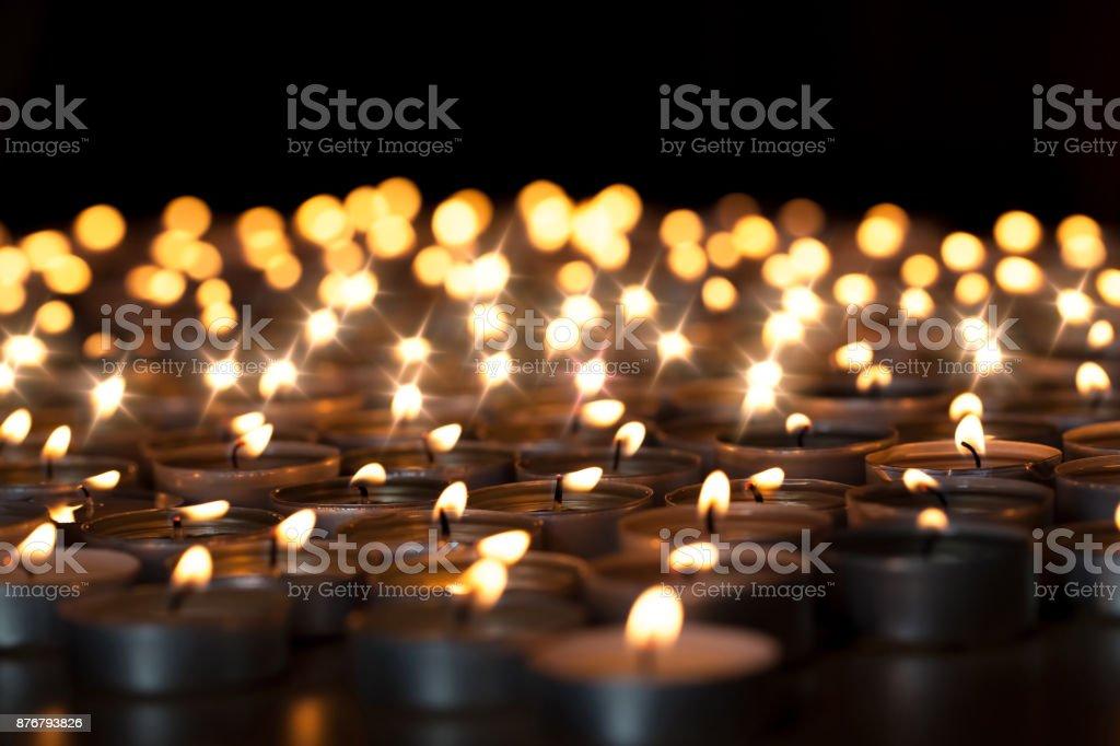 Tealight candles. Beautiful Christmas celebration, religious or remembrance candlelight image. Romantic candlelit vigil stock photo