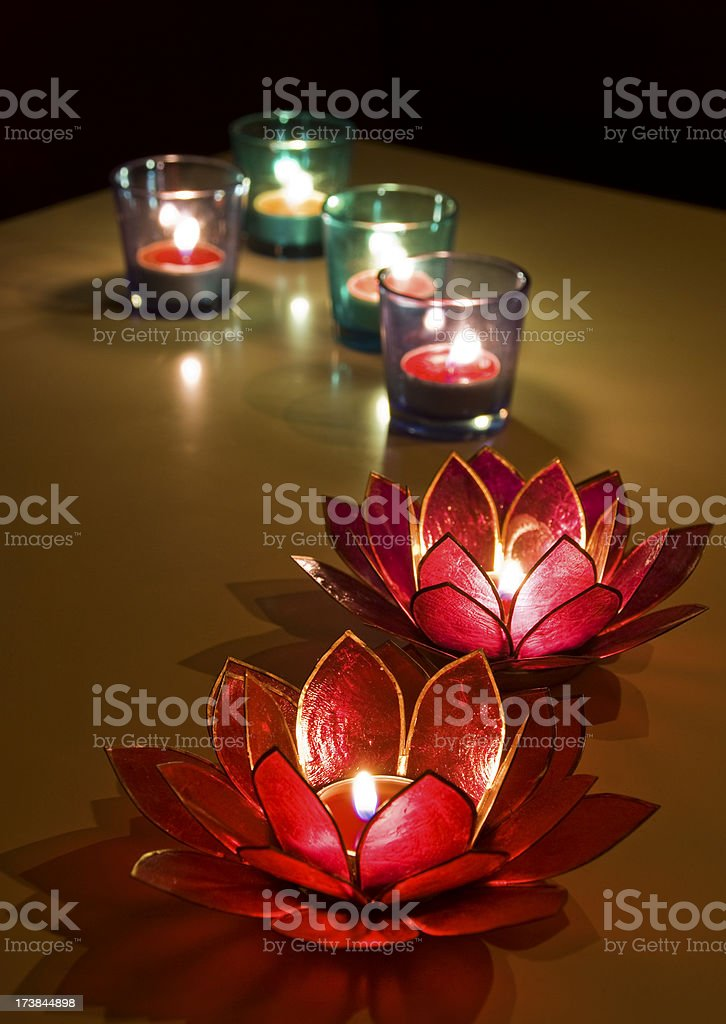 Tealights in Holders Burning on Table, Low Key royalty-free stock photo