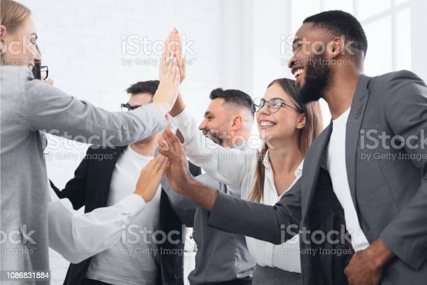 Team achievement diverse business people giving high five picture id1086831884?b=1&k=6&m=1086831884&s=612x612&h=9oxt77 lsjlbgmrmddpg3vnm2n8wdsoelyklr5tg kk=