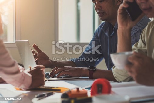 istock Team architect engineer design discussing with blueprint on table in the office. Engineering tools and construction concept. 1130683043