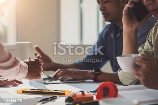 istock Team architect engineer design discussing with blueprint on table in the office. Engineering tools and construction concept. 1130683175