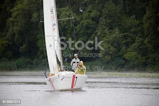 1011210354 istock photo Team athletes participating in the sailing competition 619391374