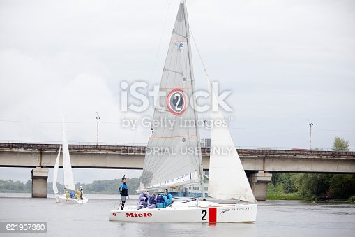 1011210354 istock photo Team athletes participating in the sailing competition 621907380