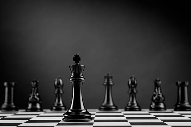 Team, Black Chess King on chess board, leader and competition stock photo
