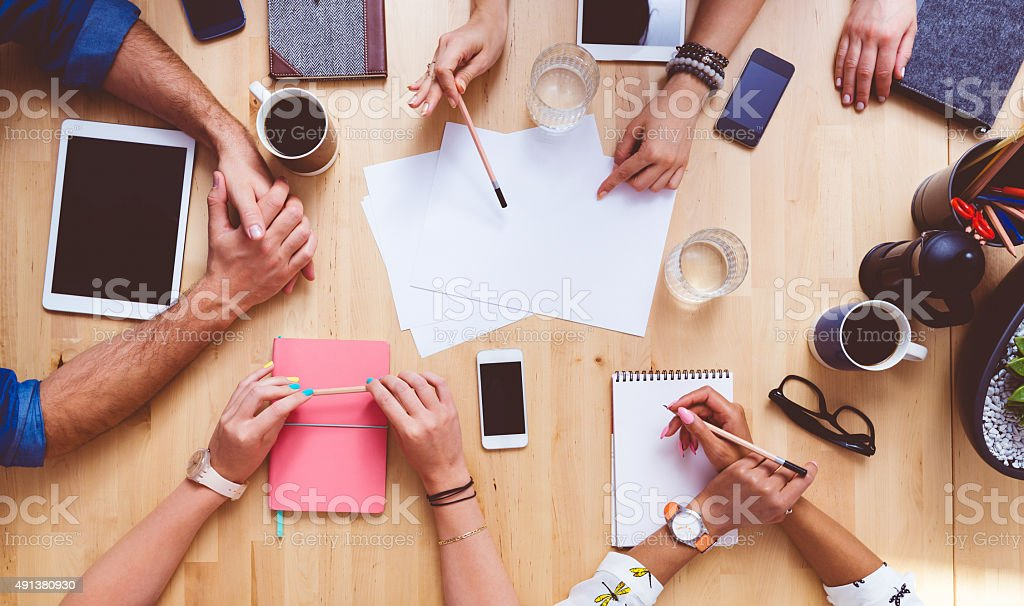 Team brainstorming, high angle view on the table stock photo