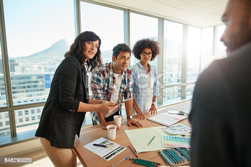 842214626 istock photo Team brainstorming over new designs in office 848290020
