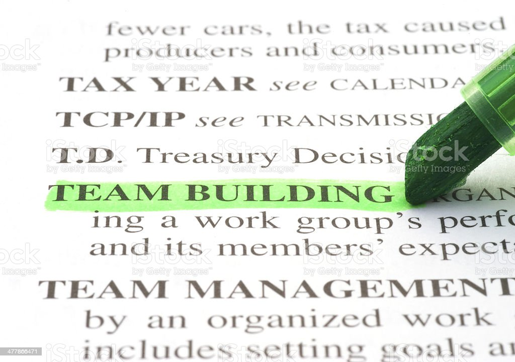 team building definition highligted in dictionary teambuilding stock photo