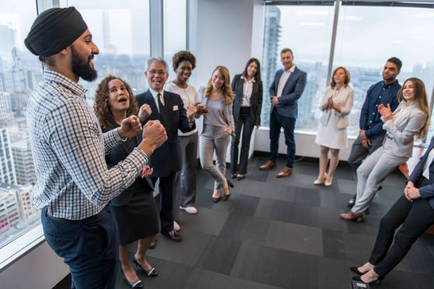 Team building in a high-rise city office stock photo