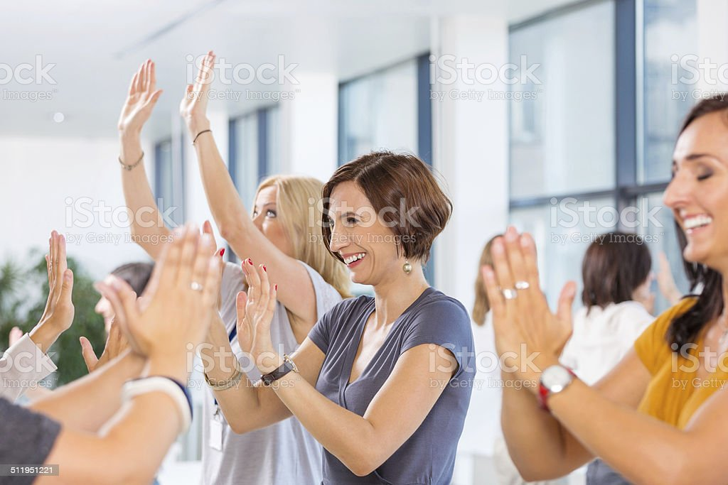 Team building Group of women attending a training, playing together. 30-39 Years Stock Photo