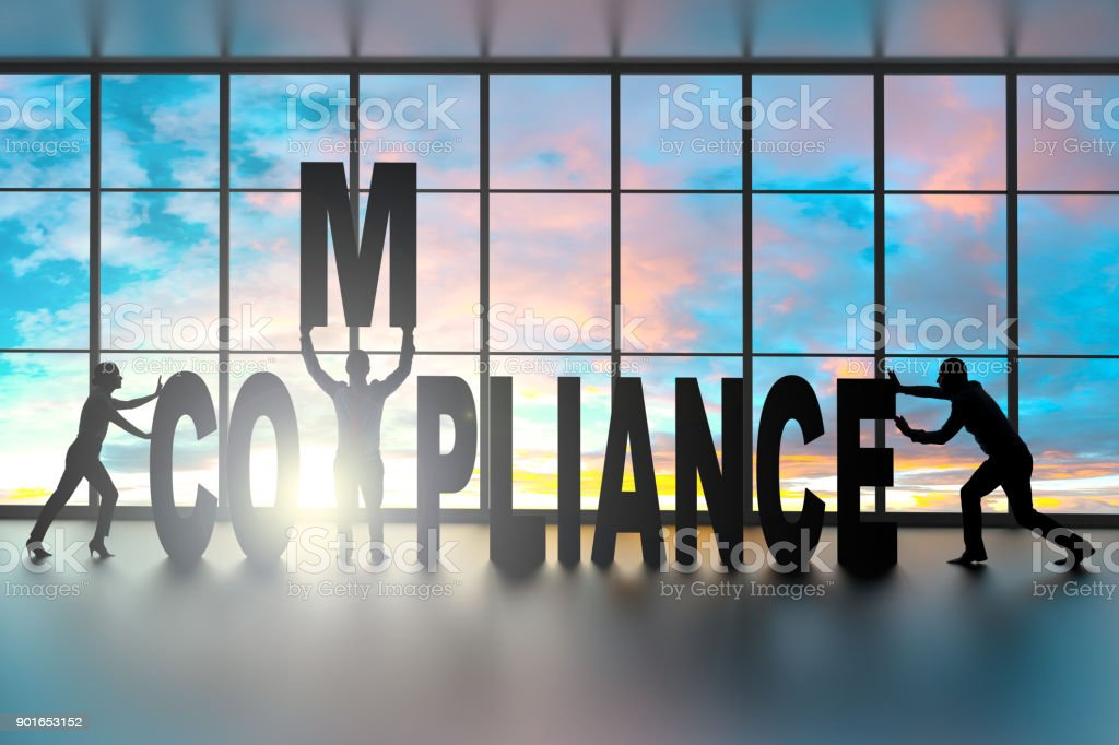 Team building the word Compliance stock photo