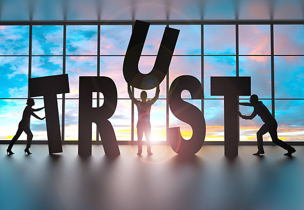 Team building the word trust stock photo