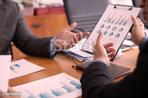 istock Team business analysts make decisions about economy that affect future operations of the company.concept 1156183345