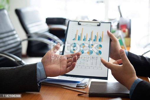 istock Team business analysts make decisions about the US economy that affect future operations of the company.concept 1182596366