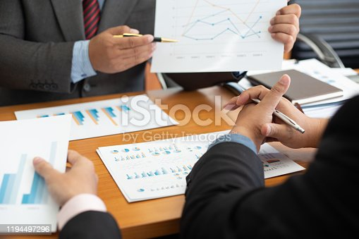 istock Team business analysts make decisions about the US economy that affect future operations of the company.concept 1194497296