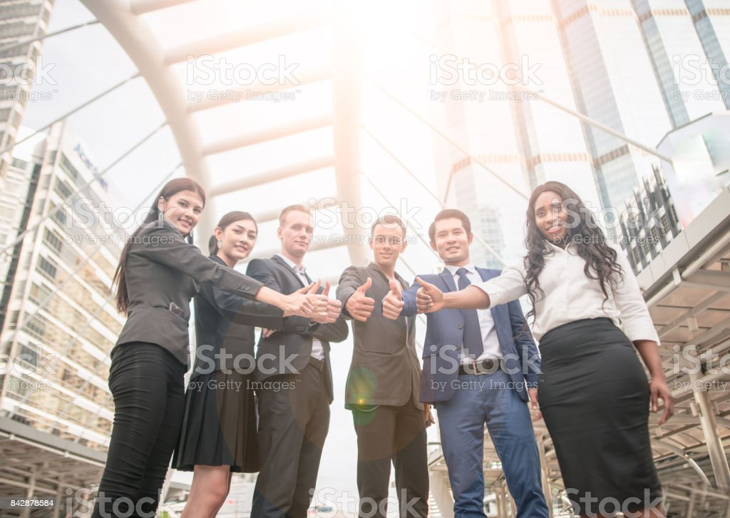 Team Business Partners Giving Thumb up Bump stock photo