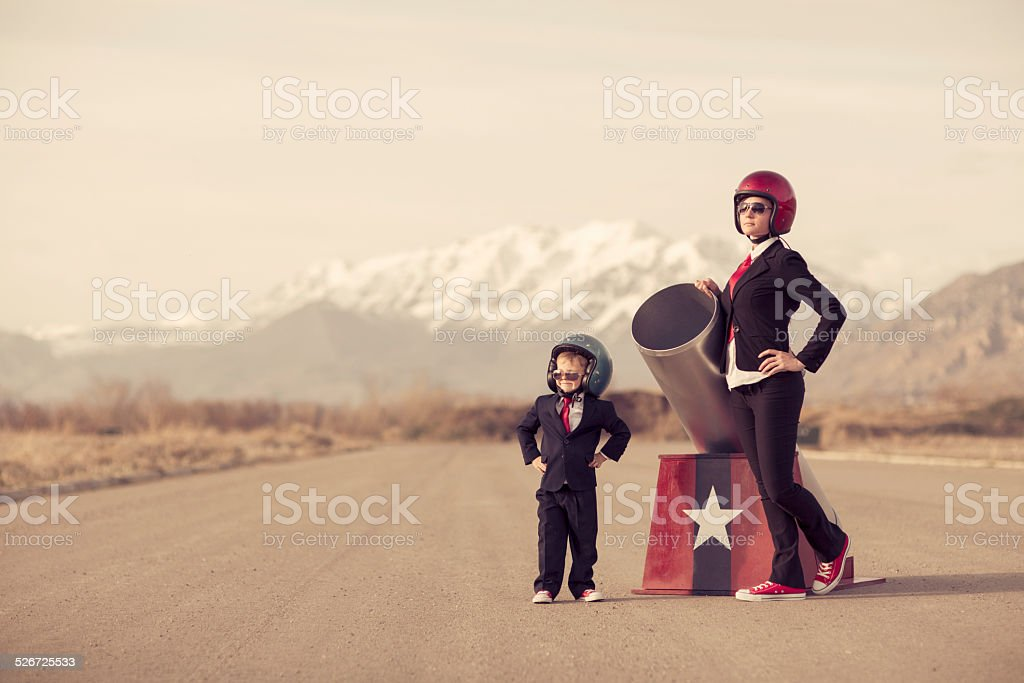 Team Business Suits Stand with Human Cannon stock photo