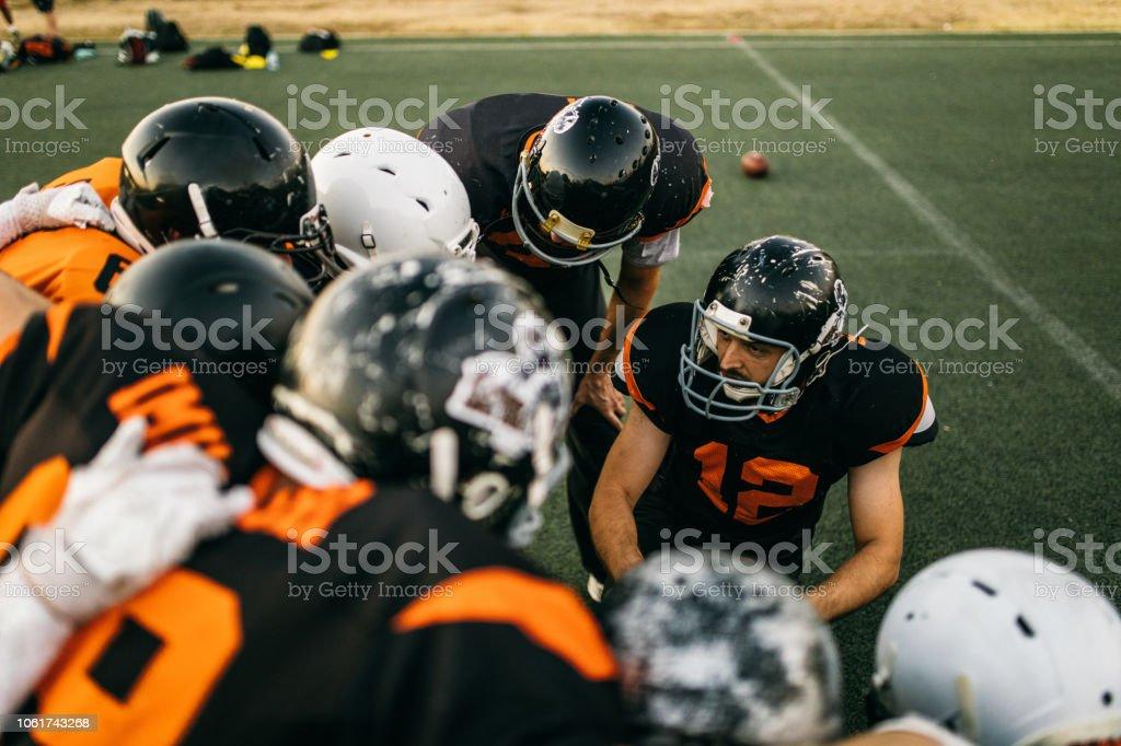 Team Captain Explaining Strategy To Fellow Players stock photo