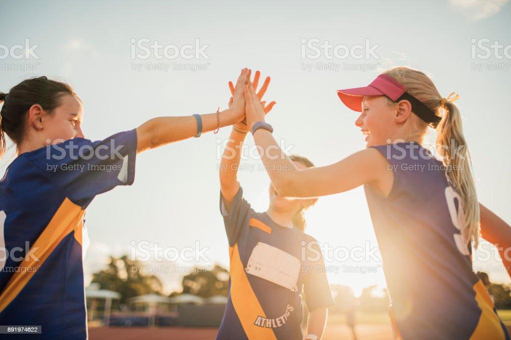 Team Celebration In Athletics Club - foto stock