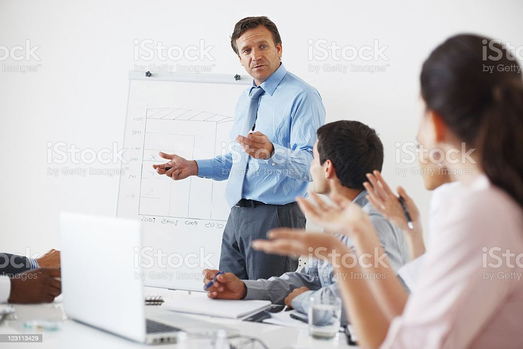 Team discussing during presentation royalty-free stock photo