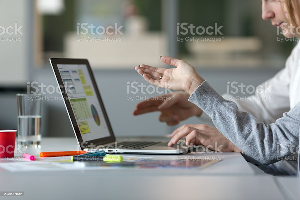 Team discussing Project pointing on Computer at modern Office stock photo