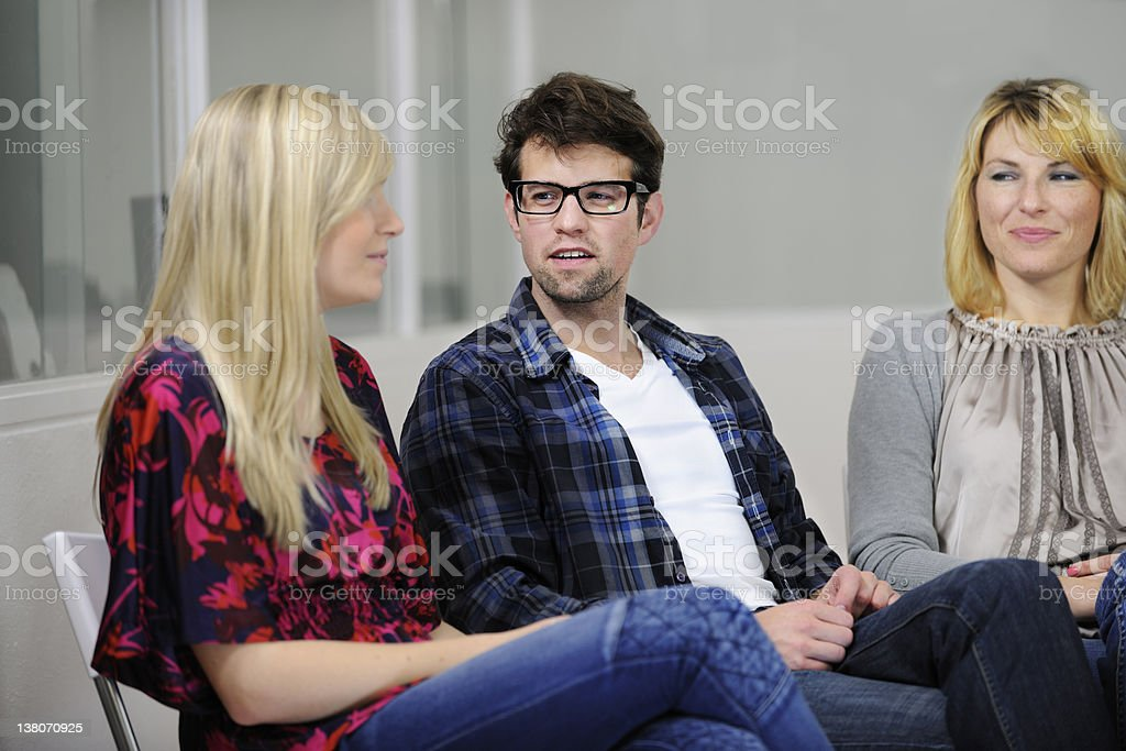 Team discussion in a circle royalty-free stock photo
