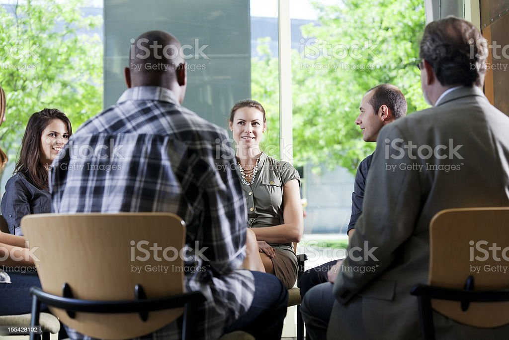 Team discussion in a cirle royalty-free stock photo
