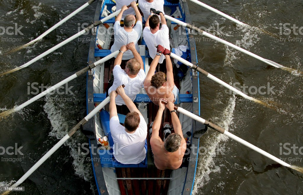 Team Effort in a Rowboat stock photo