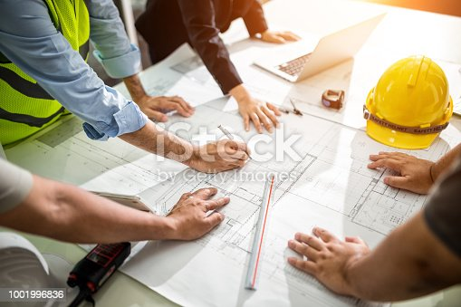 Team Engineer drawing graphic planning of interior creation project cooperating with talented teacher giving advice, working concept.