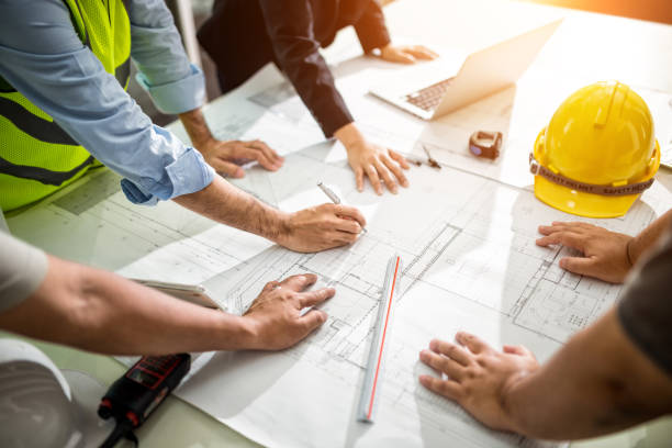 Team Engineer drawing graphic planning Team Engineer drawing graphic planning of interior creation project cooperating with talented teacher giving advice, working concept. engineering stock pictures, royalty-free photos & images