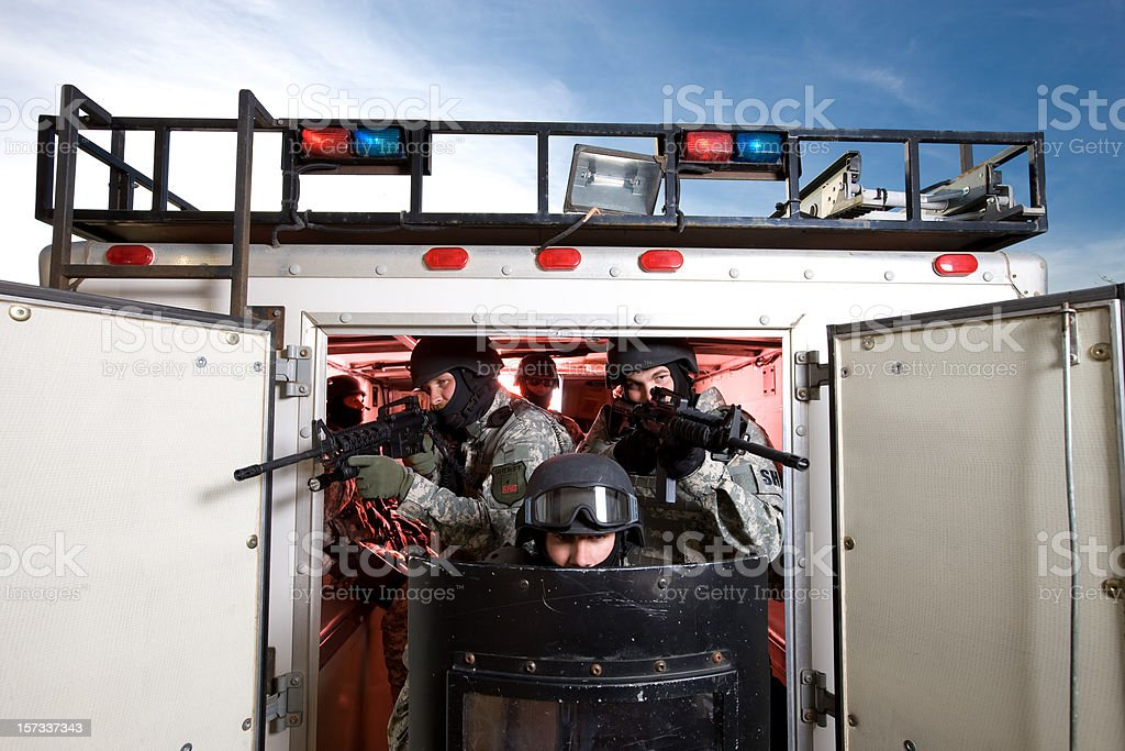SWAT Team Exiting Transport Vehicle With Riot Gear royalty-free stock photo