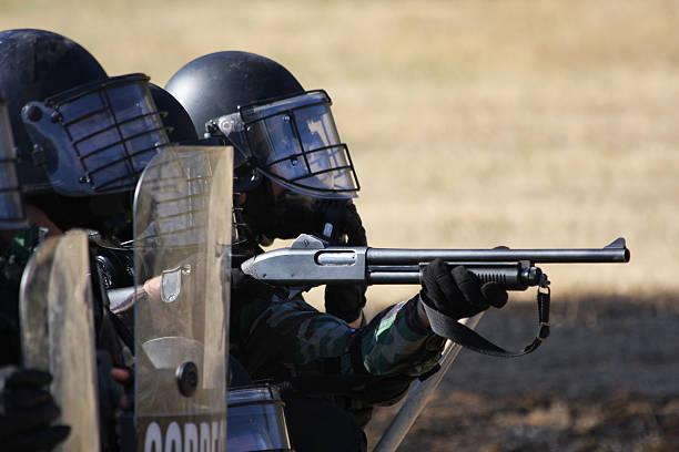 SWAT Team fires stock photo