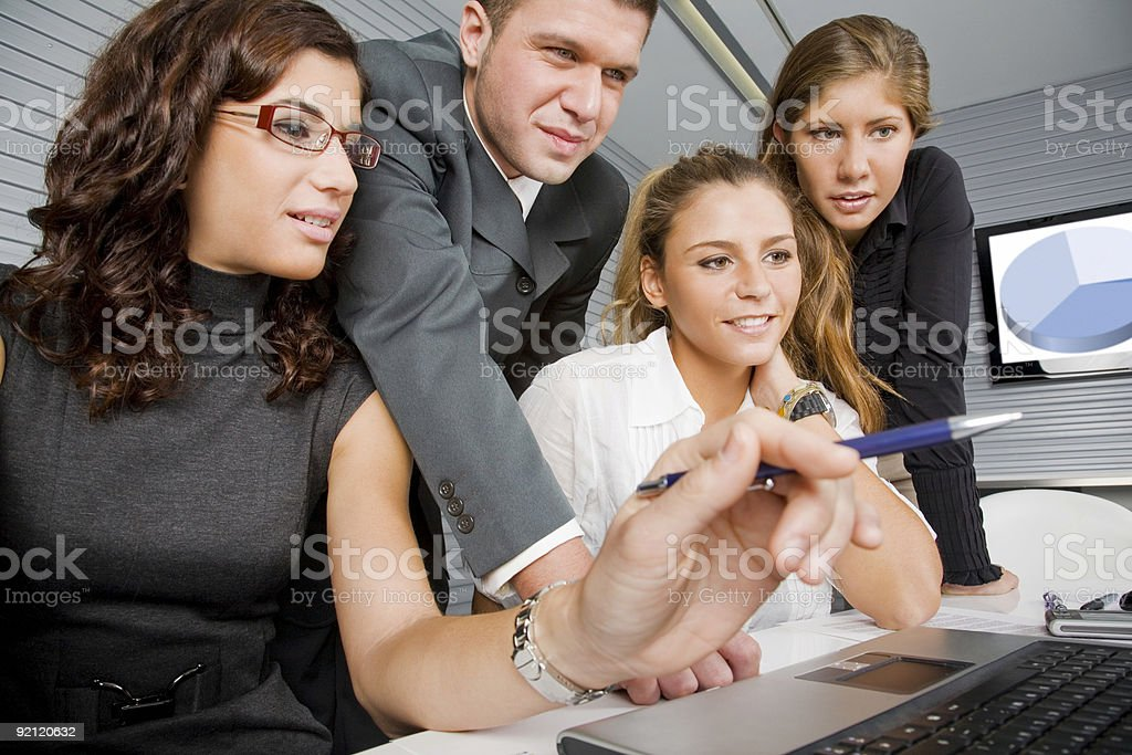 Team going over their presentation royalty-free stock photo