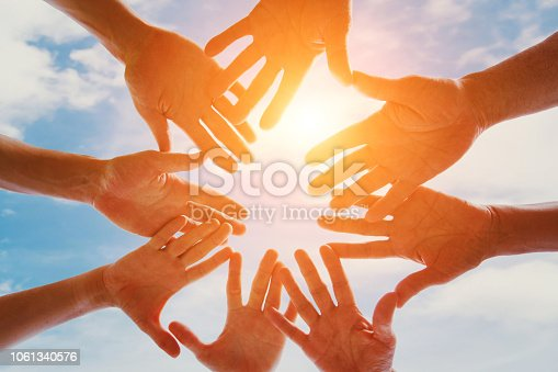 istock Team hands together, community and unity concept. Volunteer help. 1061340576