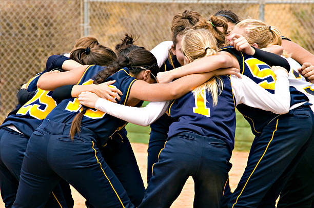 team huddle - softball stock photos and pictures