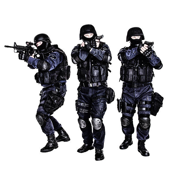 SWAT team in action Special weapons and tactics (SWAT) team in action counter terrorism stock pictures, royalty-free photos & images