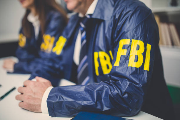 FBI team in office Two people, man and woman, working together in office, FBI team. police meeting stock pictures, royalty-free photos & images