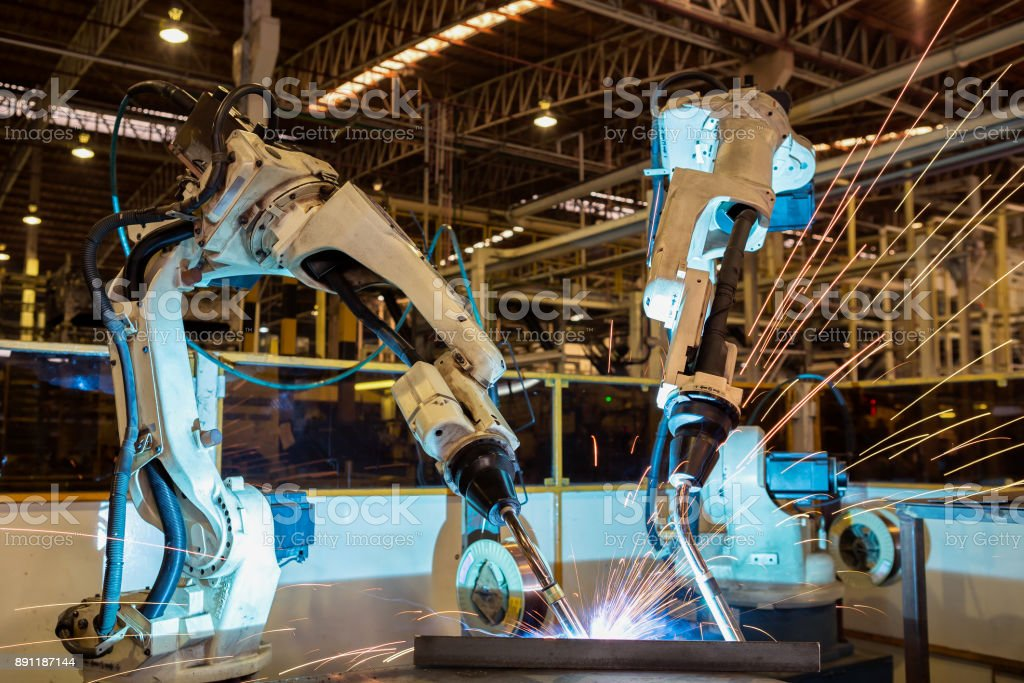 Team industrial robot are welding in automotive industrial factory stock photo