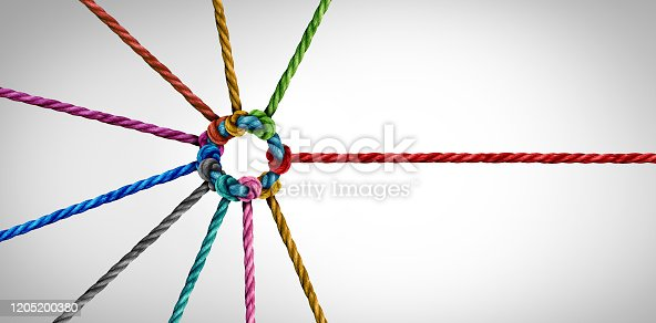 Team joining concept and unity or teamwork concept as a business metaphor for partnership as diverse ropes connected together as a corporate network symbol for cooperation and working collaboration.
