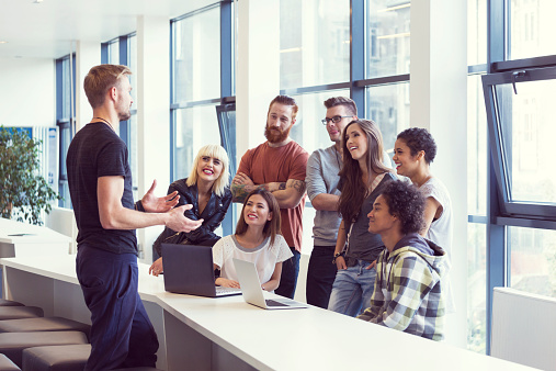 Team Leader Leading Meeting In An Office Stock Photo - Download Image Now