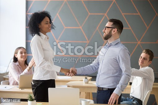 istock Team leader promoting successful african manager handshaking expressing gratitude support 963814516
