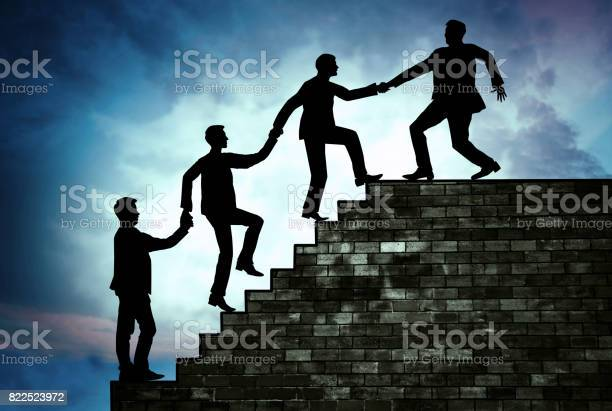 Team leader pulling his workers to the top of the stairs support of picture id822523972?b=1&k=6&m=822523972&s=612x612&h=hs9xbv5dtsutdkotcflgicd1gsyibeqvhy5xdq44xuo=