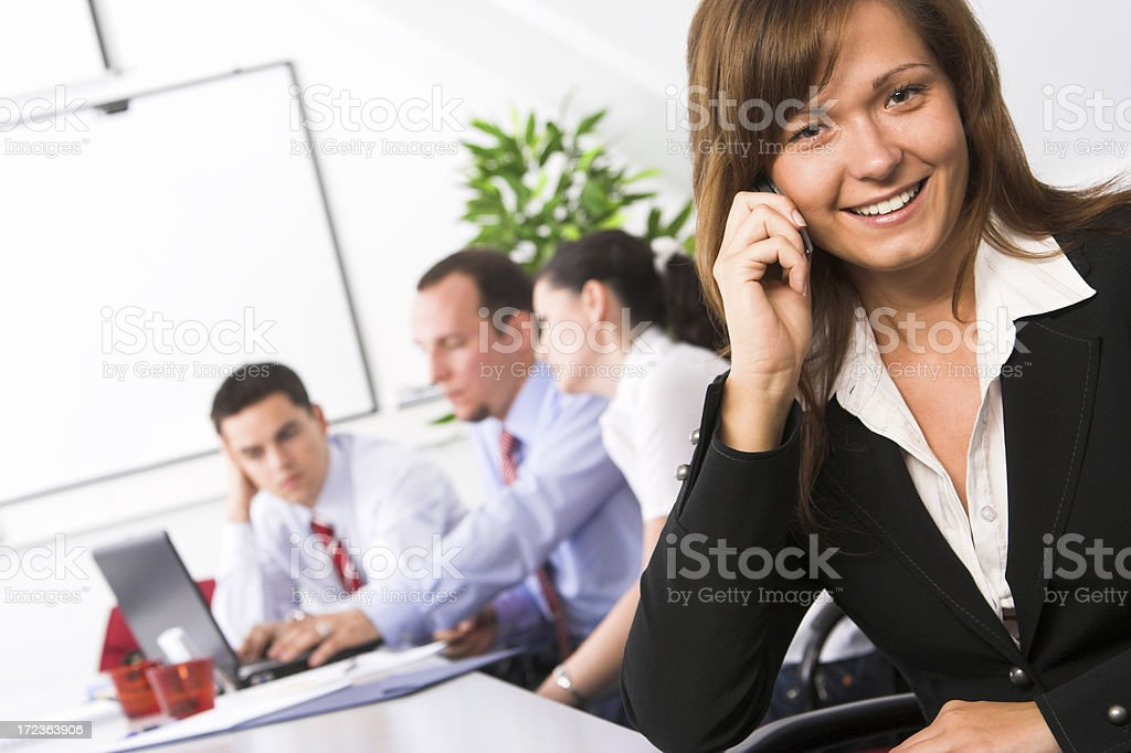 Team leader talking on cellphone royalty-free stock photo