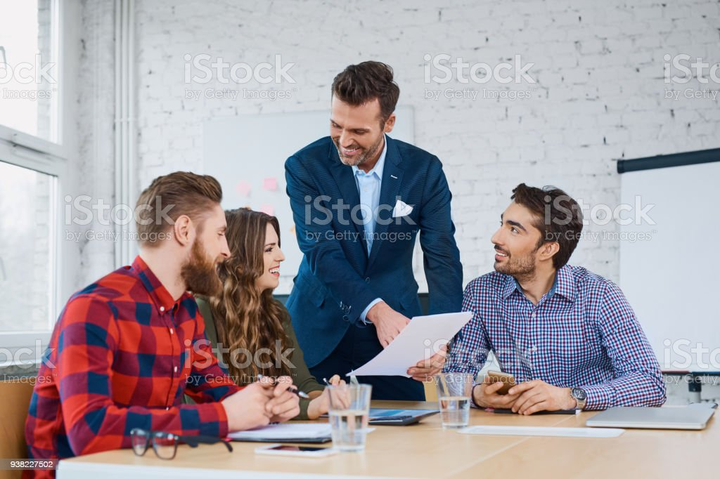 Team leader  talking with coworkers in modern office stock photo