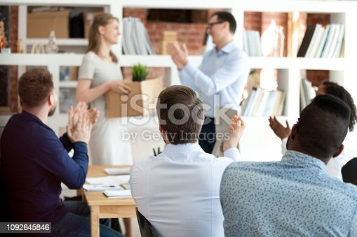 924520144 istock photo Team leader with colleagues applauding to just hired employee 1092645846