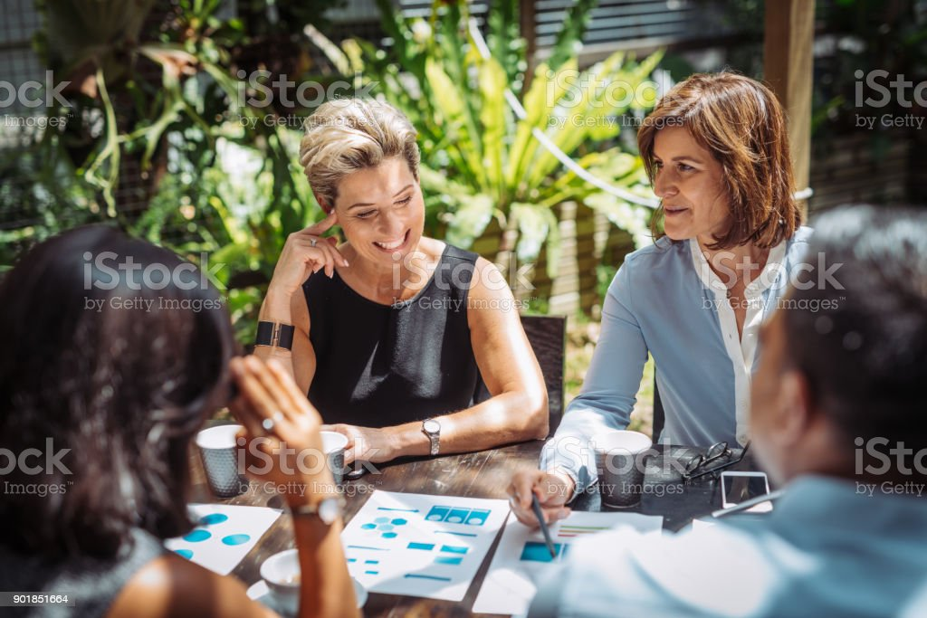 Team leaders in start up business are two experienced mature women stock photo