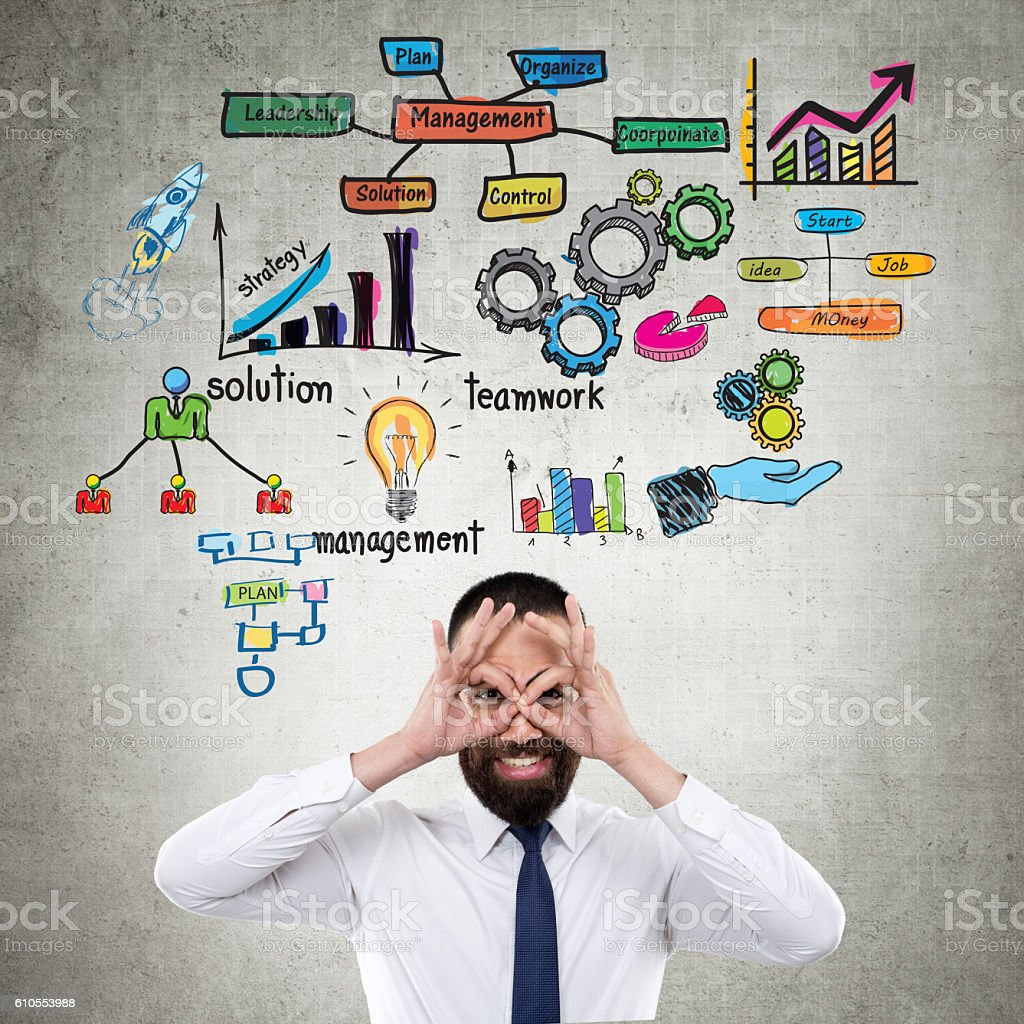 Team management concepts on wall stock photo