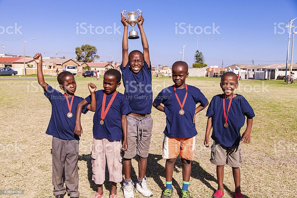Team mates showing trophy and medals, Cape Town, South Africa royalty-free stock photo