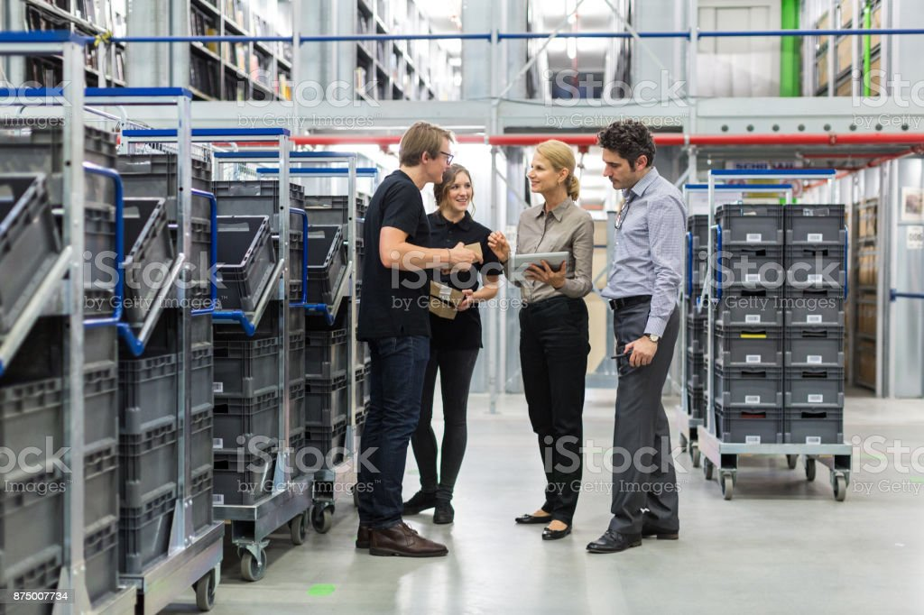 Team meeting in distribution warehouse royalty-free stock photo