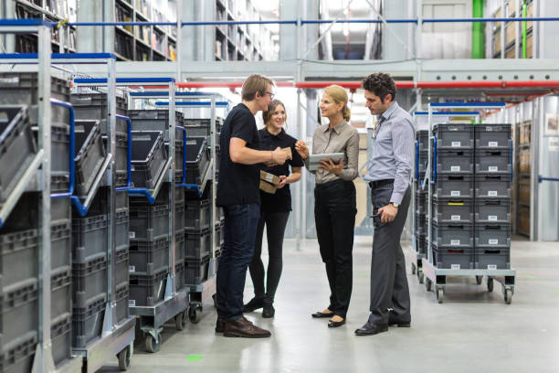 Team meeting in distribution warehouse stock photo