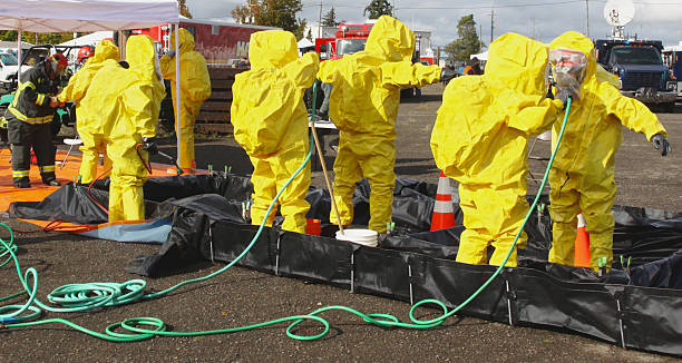 HAZMAT Team Members Clean Up 2 HAZMAT Team Members Clean Up 2 decontamination stock pictures, royalty-free photos & images